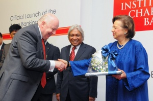 AIF's CEO Dr Raymond Madden receiving a token of appreciation from Y Bhg Tan Sri Dr Zeti Akhtar Aziz, while Bank Negara's Deputy Governor Y Bhg Dato' Muhammad bin Ibrahim looks on